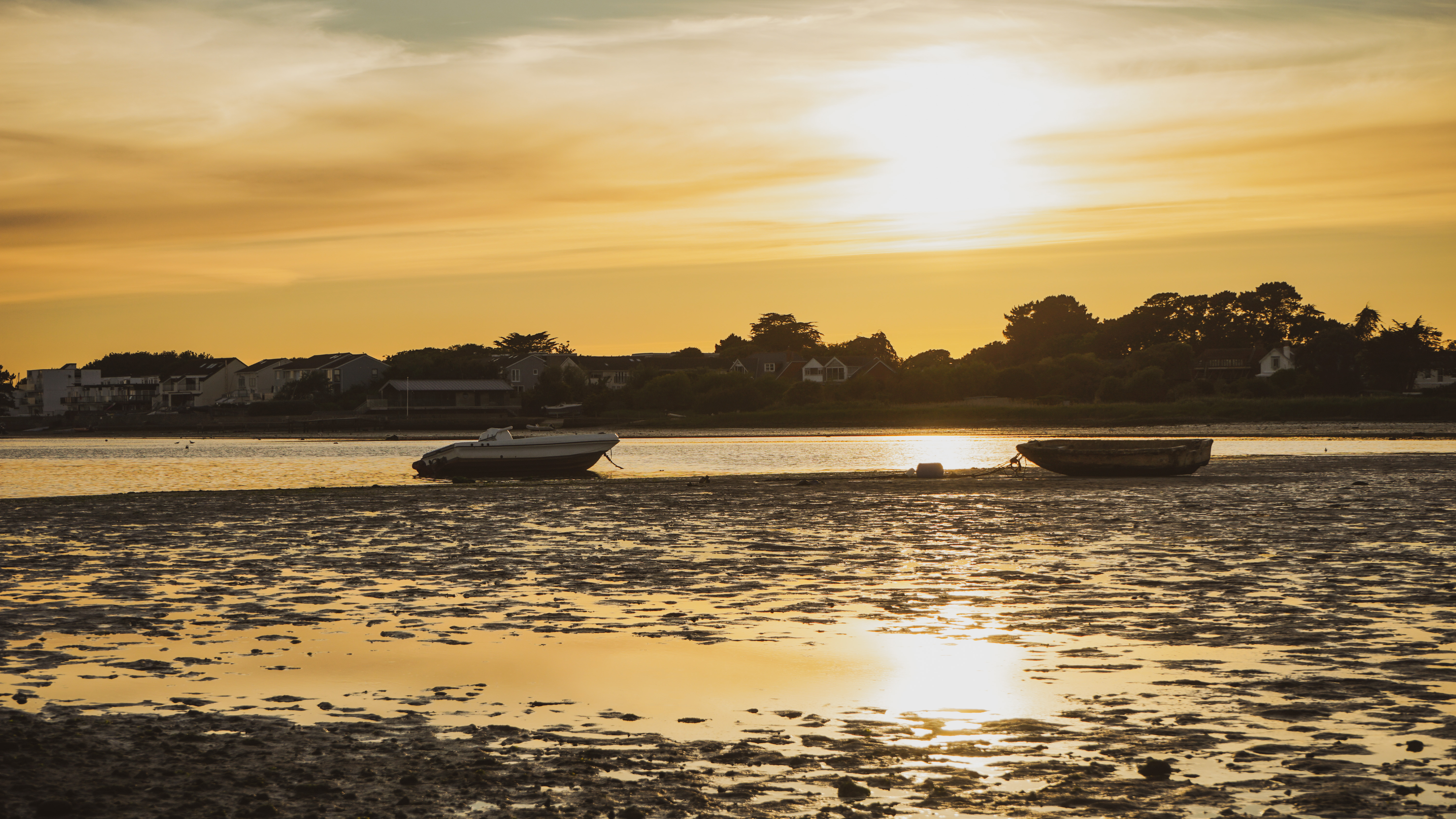 Tranquil sunset at Mudeford quay with tow boats moored on the sea bed due to low tide