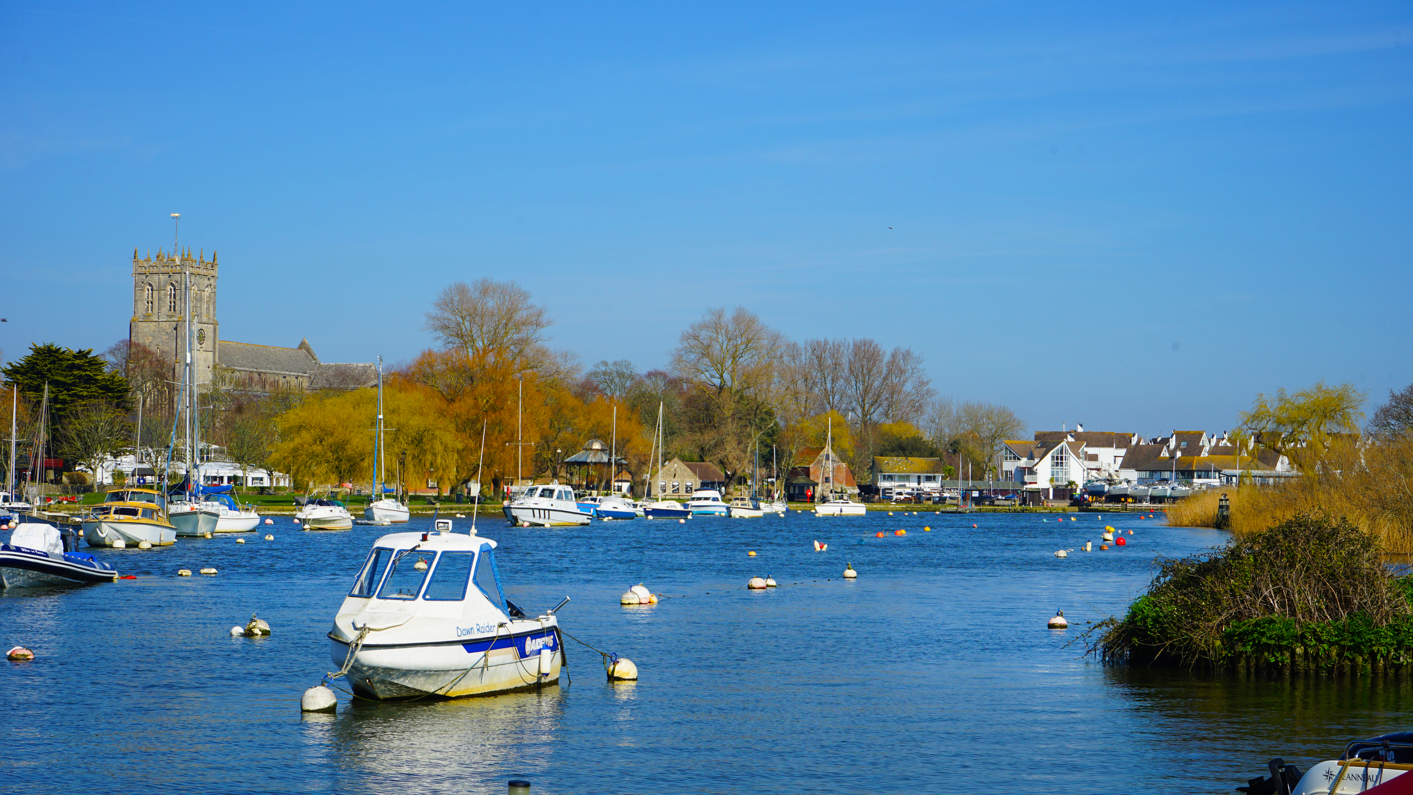 Boats moored in the river and Christchurch