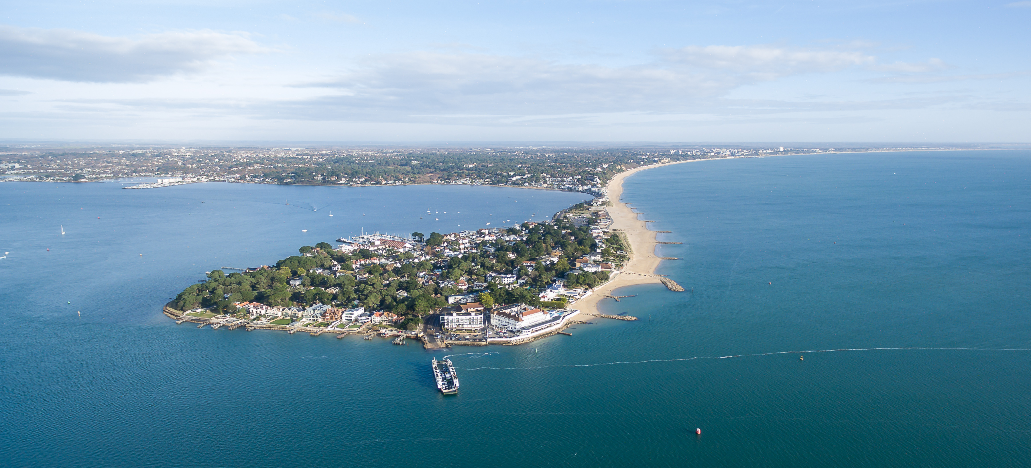 Arial shot of sandbanks and the beaches with the ferry leaving