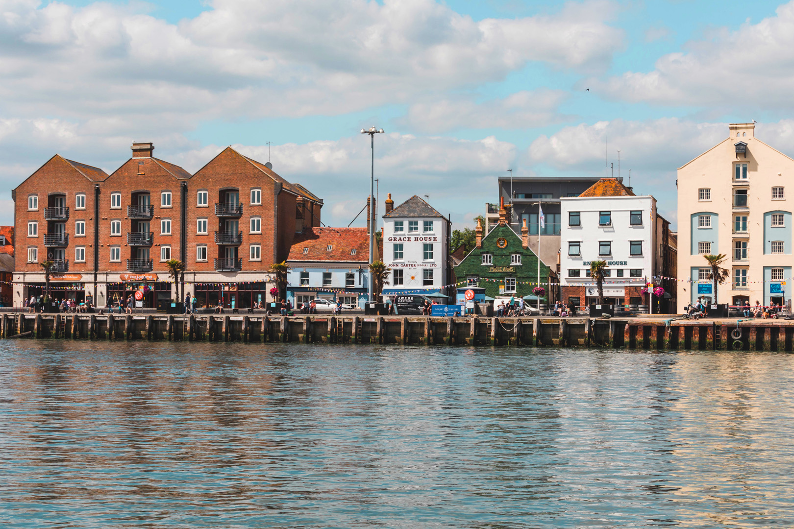 A neat shot of the different building all lined up along Poole Quay with bunting running across the front of them