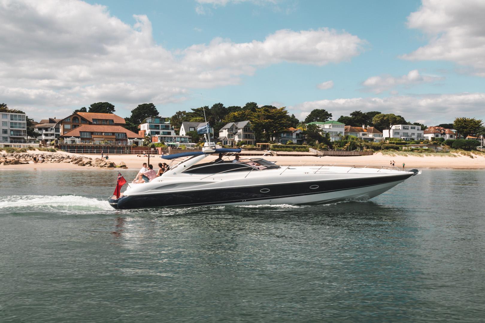 Shot alongside a speed boat jetting off from sandbanks beach in Poole